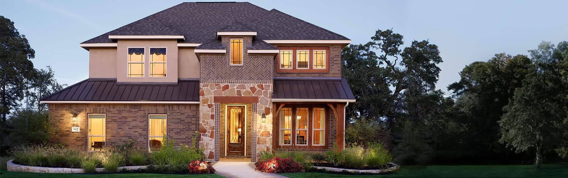 Gehan Homes Classic Redwood Floorplan Elevation – metal roofing, stone entryway & brick exterior