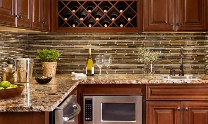 Interior of Gehan Home Stanford Bar with granite countertops and tiled backsplash with stainless steel appliances