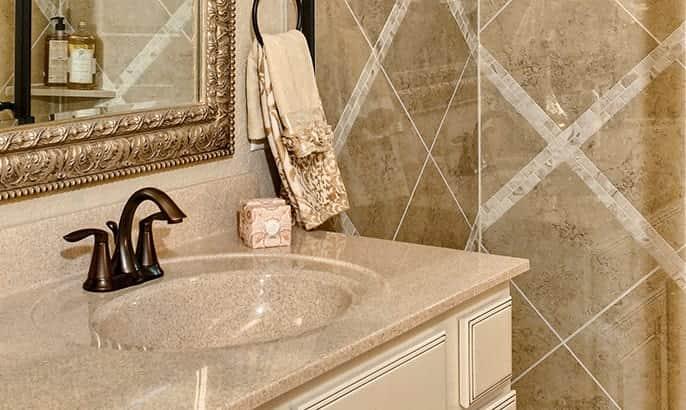 Gehan Homes Master bathroom sink & vanity with granite backsplash