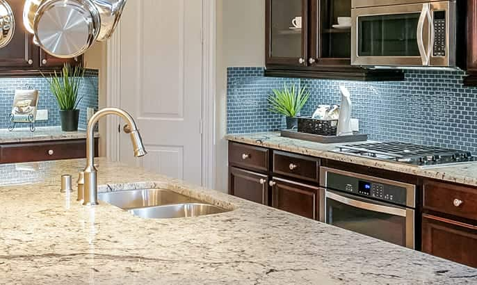 Gehan Homes Palm Kitchen Island with stainless steel appliances & granite countertops