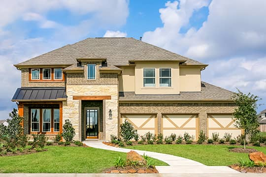 Two story Gehan homes elevation with 3 car garage, covered entry & manicured garden