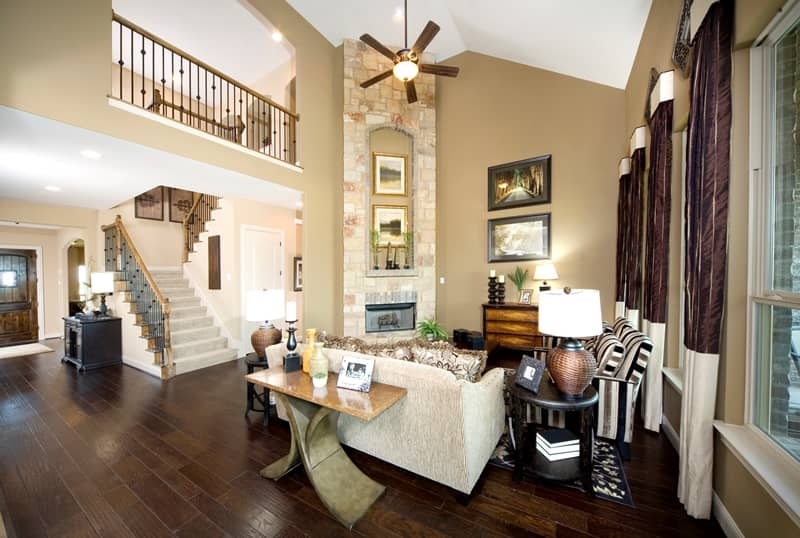 Two story Gehan home interior with vaulted ceilings, fireplace & stained wood floors
